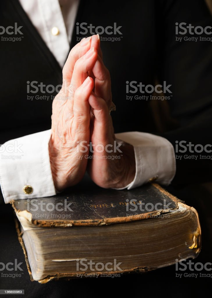 Old Hands on an Antique Bible royalty-free stock photo