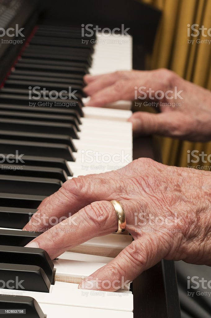Old Hands on the Piano royalty-free stock photo