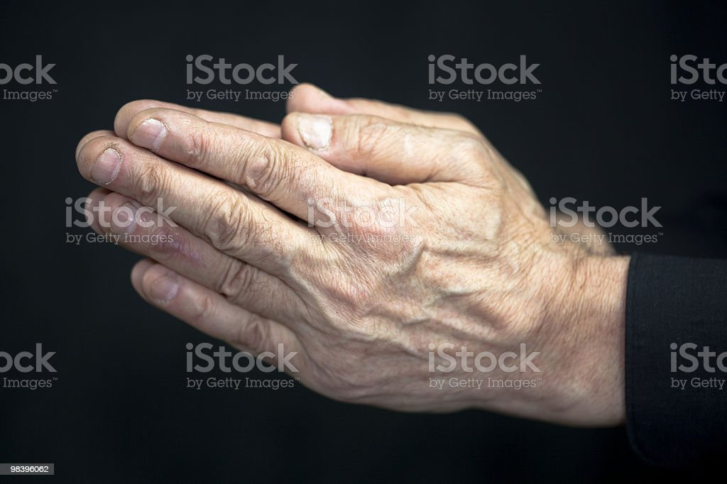 Old hands praying royalty-free stock photo