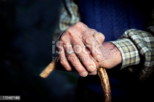 istock Old hands with walking stick 172457185