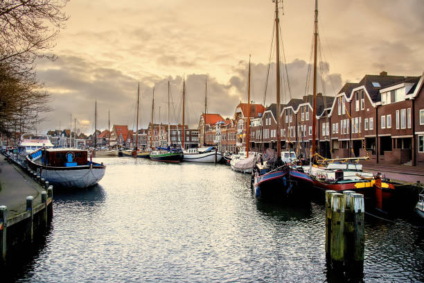 Old harbor in Hoorn, Holland View on the yacht harbor at the evening, Hoorn, Netherlands horned stock pictures, royalty-free photos & images