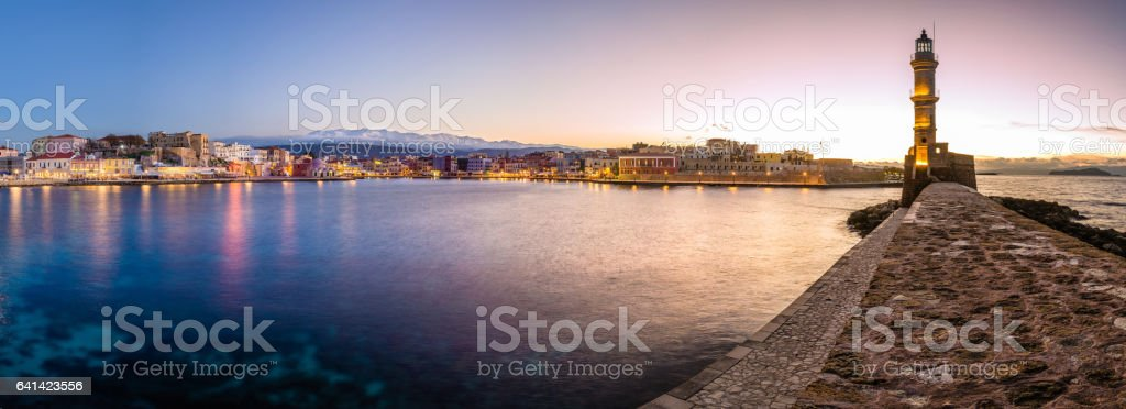Old harbor of Chania with the lighthouse, at sunset. stock photo