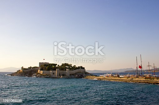 People visit the old harbor on Pigeon Island (güvercin ada) that Kusadasi castle in Turkey. It was built in Byzantine Era, now the castle houses the museum and is the lovely place for many tourists. There is a statue of Barbaros Hayrettin Paşa who is ottoman sailor.