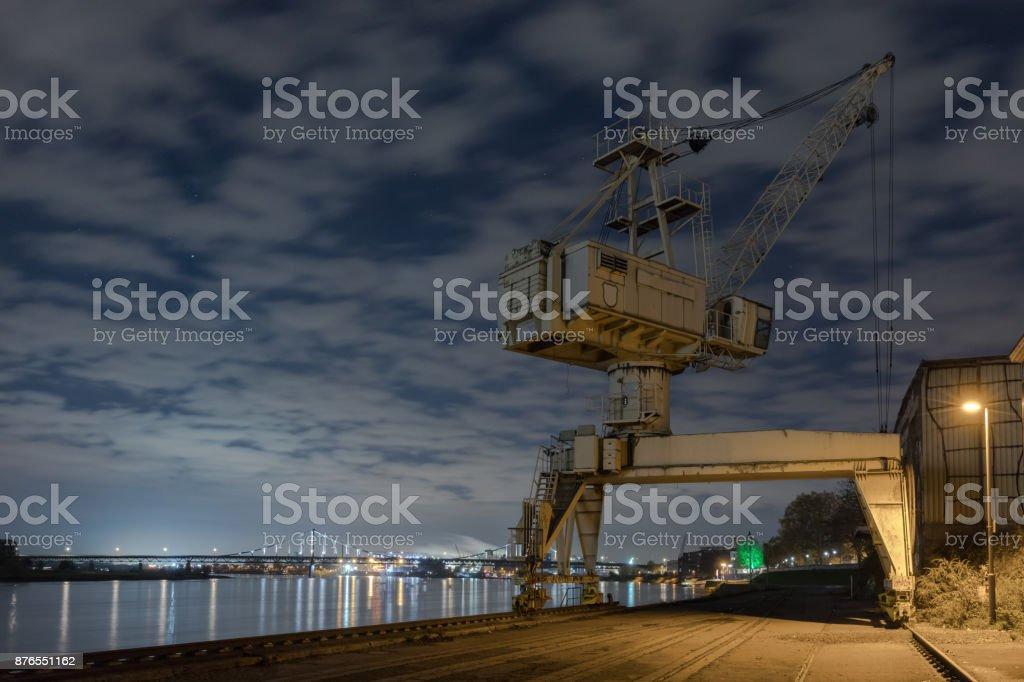 Alter Hafenkran bei Nacht in Krefeld am Rhein / Niederrhein stock photo
