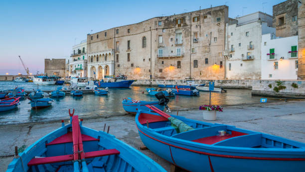 Old harbour in Monopoli at sunset, Bari Province, Puglia (Apulia), southern Italy. stock photo