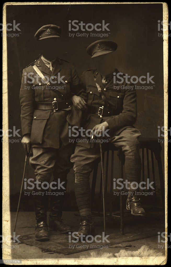 Old headless soldier friends stock photo