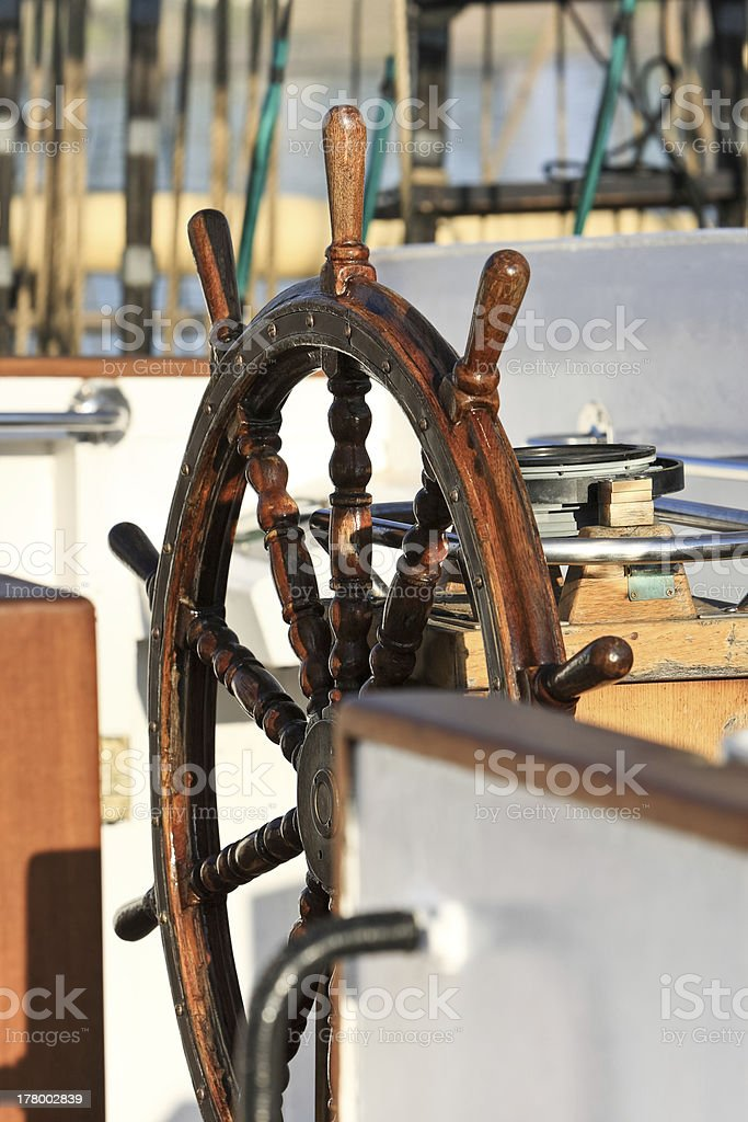Old helm on sailing ship royalty-free stock photo