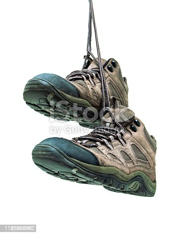 Old hiking boots isolated on white background
