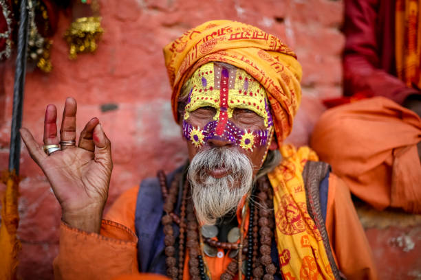 Old Hindu Saint or Sadhu Kathmandu, Nepal - November 4 2018: Old Hindu saint happily posing for a photo. bodhisattva stock pictures, royalty-free photos & images