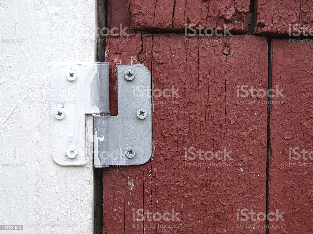 Old hinge on a wooden door royalty-free stock photo