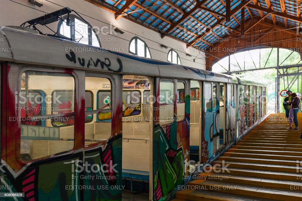 Old hippie style funicular train at station of Tibidabo attraction park. stock photo