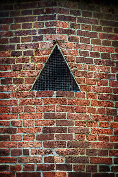 Old Historic Civil War Brick Wall With Black Triangle Old Historic Civil War Brick Wall With Black Triangle  civil war memorial minnesota stock pictures, royalty-free photos & images