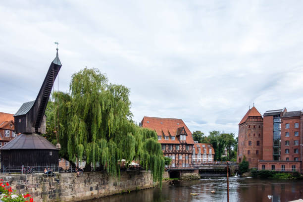 Old historic harbor of Luneburg with half-timbered houses and crane an river in Schleswig-Holstein Germany Old historic harbor of Luneburg with half-timbered houses and crane an river in Schleswig-Holstein Germany lüneburg stock pictures, royalty-free photos & images