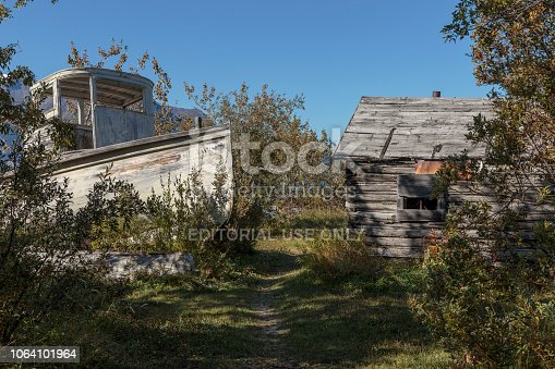 September 16 2018 Atlin Canada. Old historic house and boat  of the Gold Rush in Atlin British Columbia Canada.