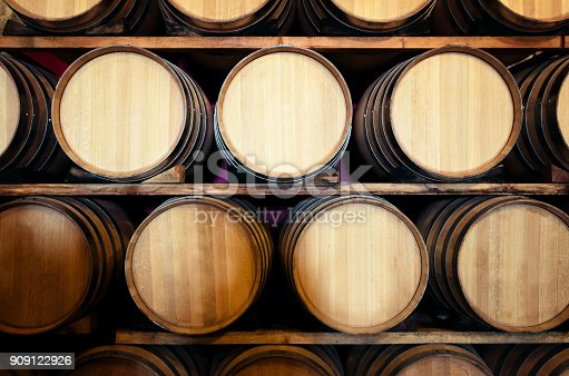 Old historic wine cellar in Langhe (Piedmont, Italy) with wooden barriques stacked