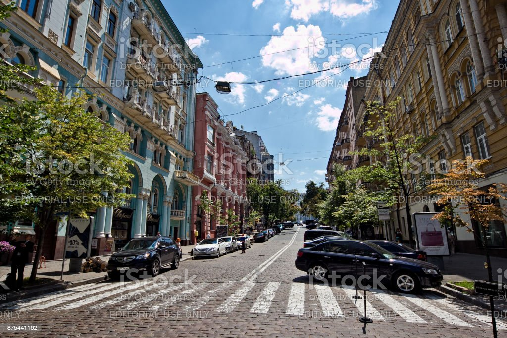 Kiev, Ukraine - July 04, 2013: Old historical part of Kiev downtown. Cobbled road and beautiful mansions stock photo