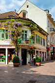 Baden Baden, Germany - May 6, 2013: Alte Hof Apotheke on Langestrasse at Old city of Baden Baden in Baden Wurttemberg region in Germany. Cityscape view of street at Bath and spa German town in Europe