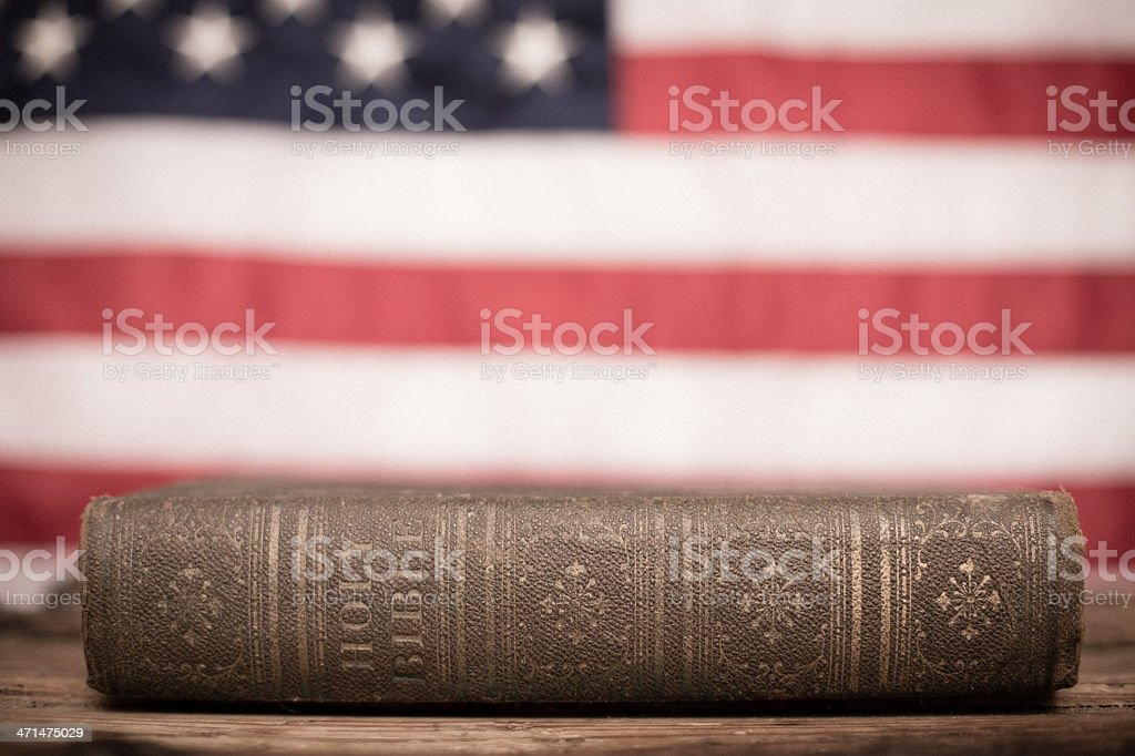 Old, Holy Bible With American Flag Background royalty-free stock photo