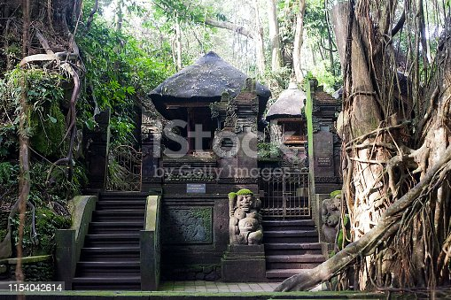 Old stone Holy Spring Temple in Ubud monkey forest, Bali, Indonesia
