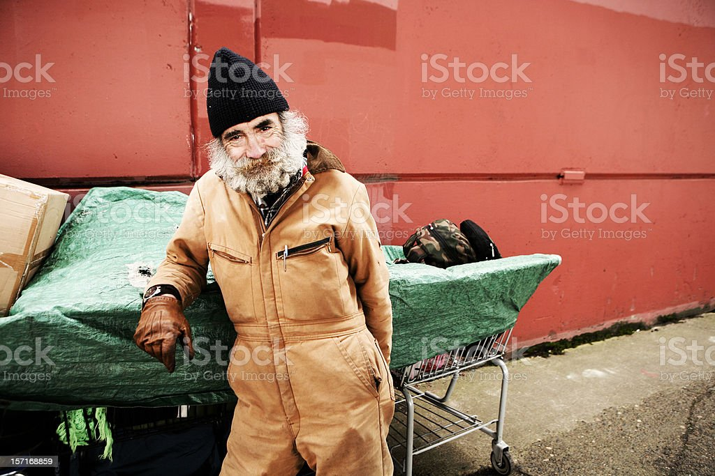 Old Homeless Male in Brown Jumpsuit royalty-free stock photo