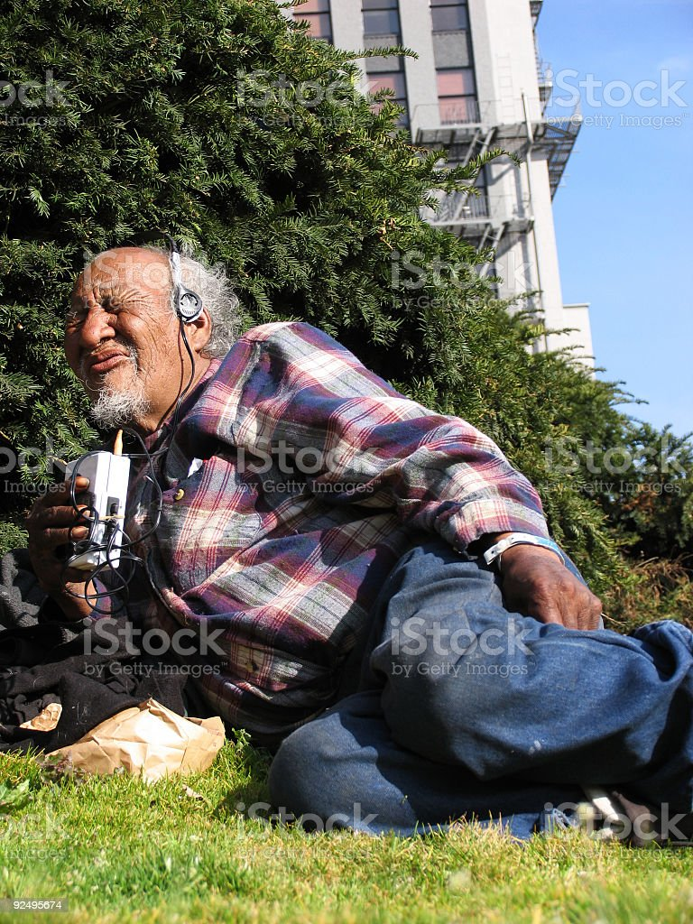 Old Homeless Man Rocking Out to Music royalty-free stock photo