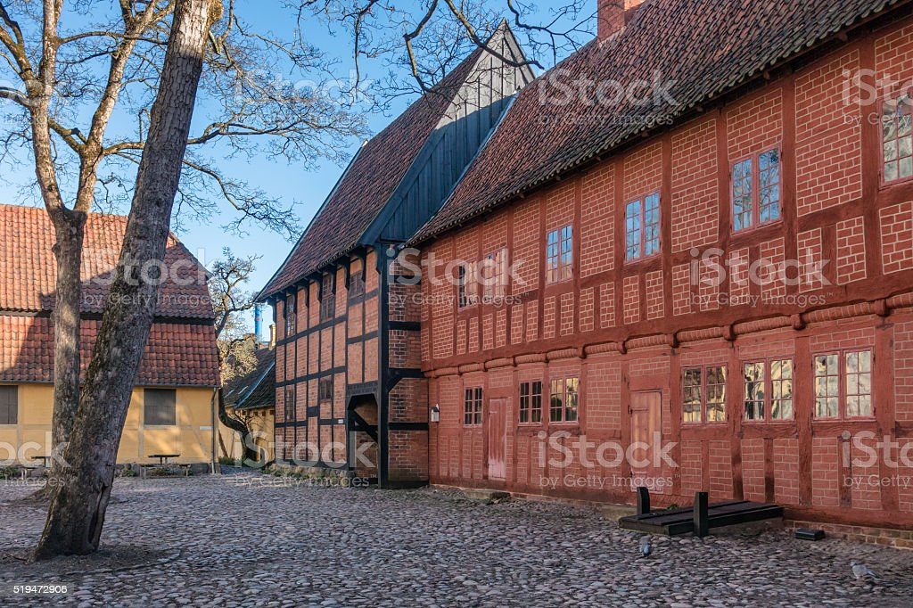 Old homes in cobbled streets in Odense stock photo