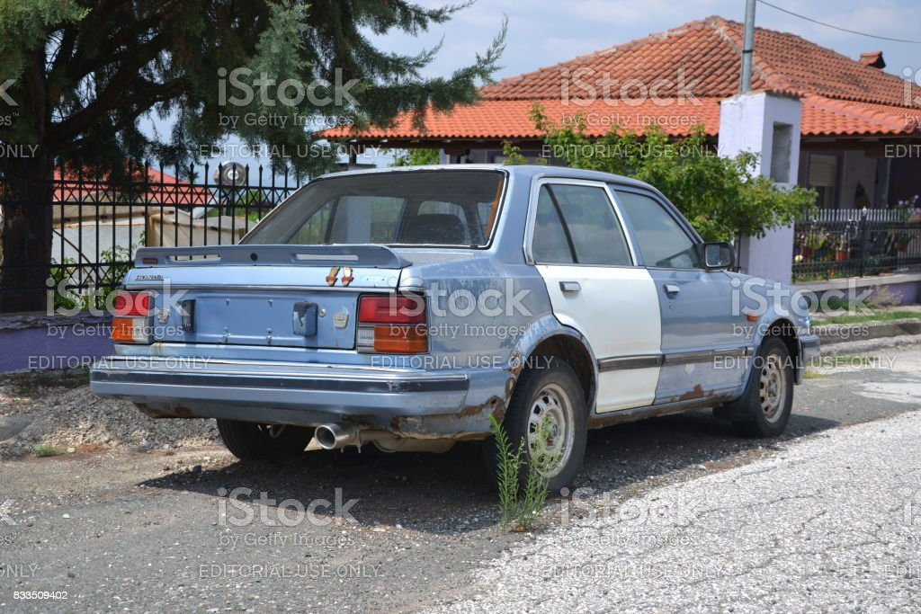Old Honda Civic dying on the street stock photo