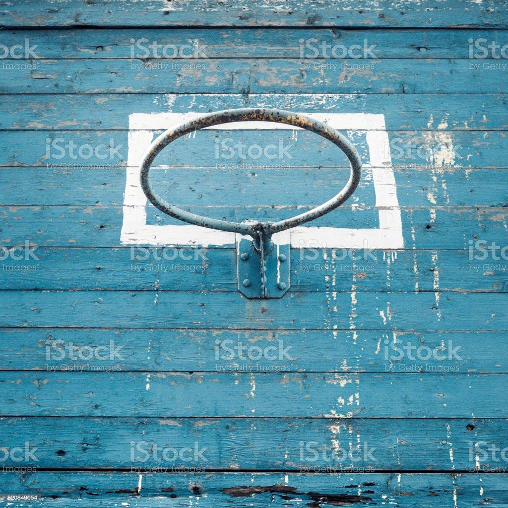 Old Hoop Basketball On Blue Wooden Background
