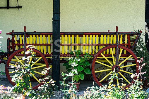 Old yellow horse cart in backyard