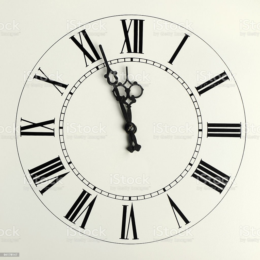 Old hours with figured arrows stock photo