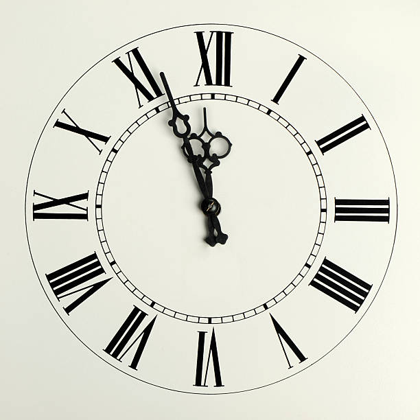 Old hours with figured arrows  midnight stock pictures, royalty-free photos & images