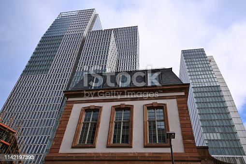 istock Old house and new skyscrapers, Frankfurt, Germany 1142197393
