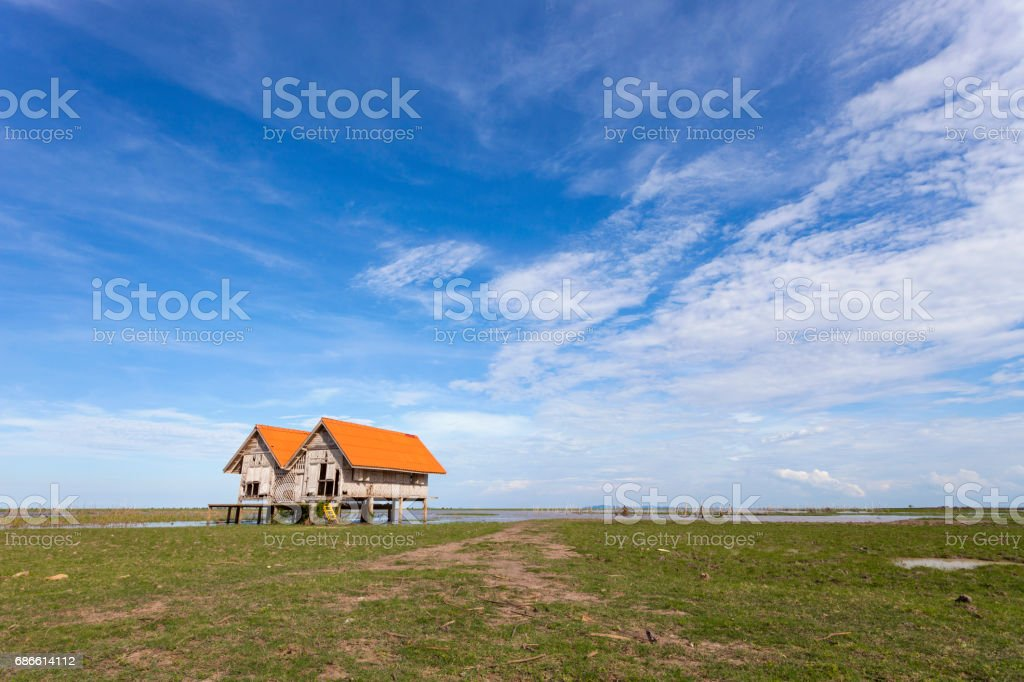 old house at Thale Noi with blue sky, Chaloem Phrakiat Bridge, Phatthalung province in Thailand. royalty-free stock photo