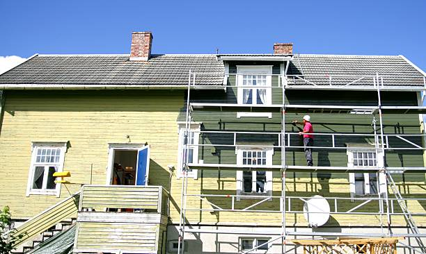 Old house being painted stock photo