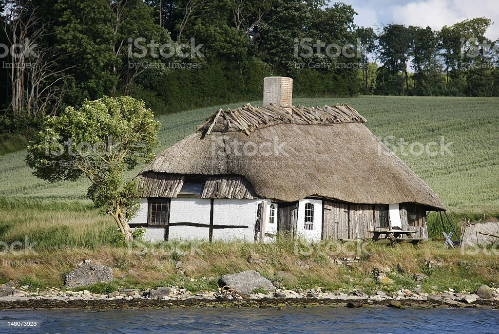 Old house by the sea stock photo