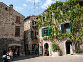 Sirmione, Italy 5, 2016: Old house covered by ivy in Sirmione on Garda Lake, Italy