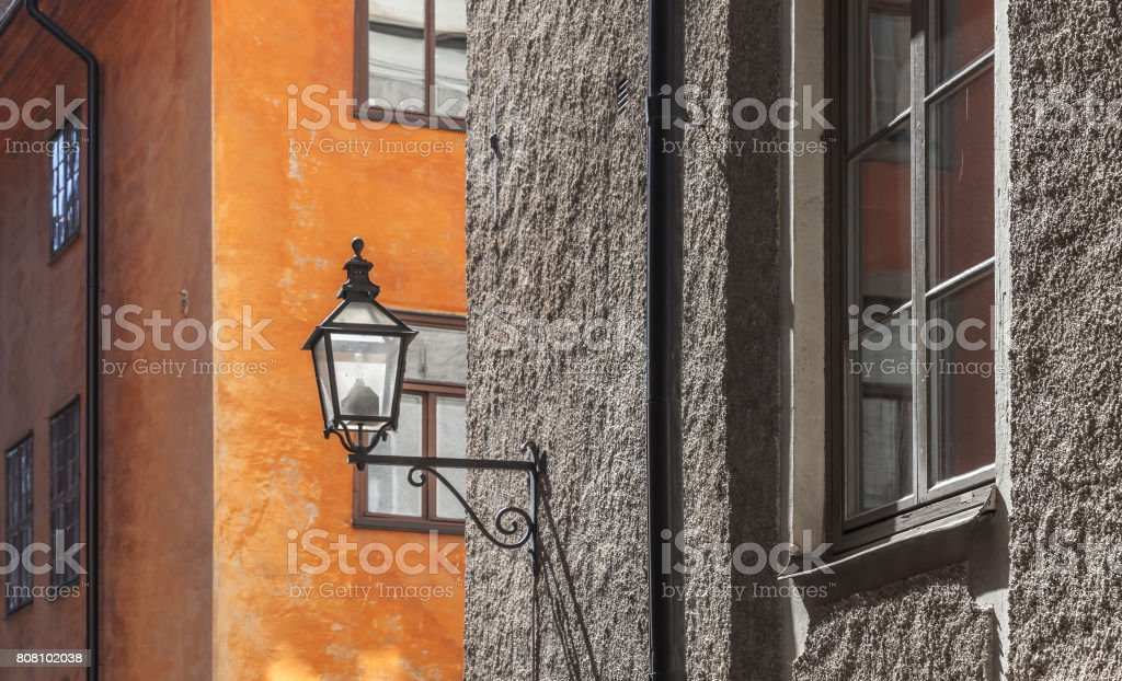 Old house facade with street lamp. Stockholm stock photo