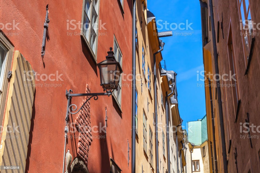 Old house facade with street light. Gamla stan stock photo
