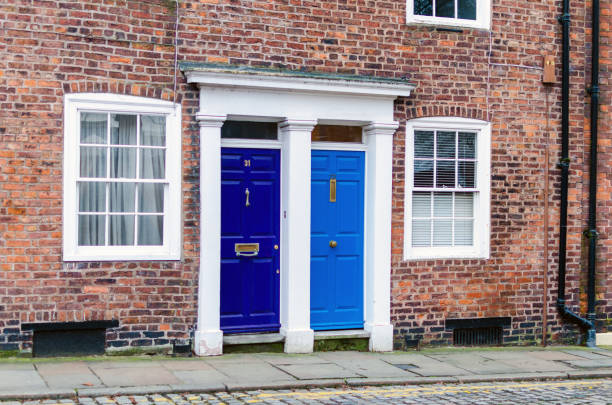 Old house front doors in England, UK Early Victorian terrace houses. The building exterior facade with old blue colorful wooden entrance doors was photographed outdoors. war effort stock pictures, royalty-free photos & images