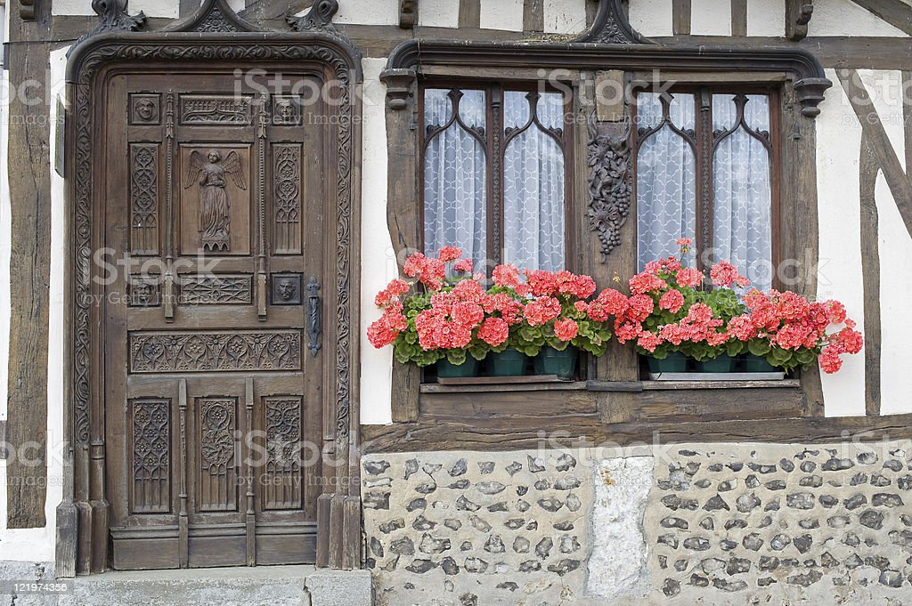 Old house in Normandy, France: exterior with flowers royalty-free stock photo