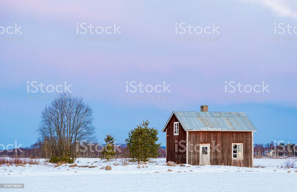 Old house on a field stock photo