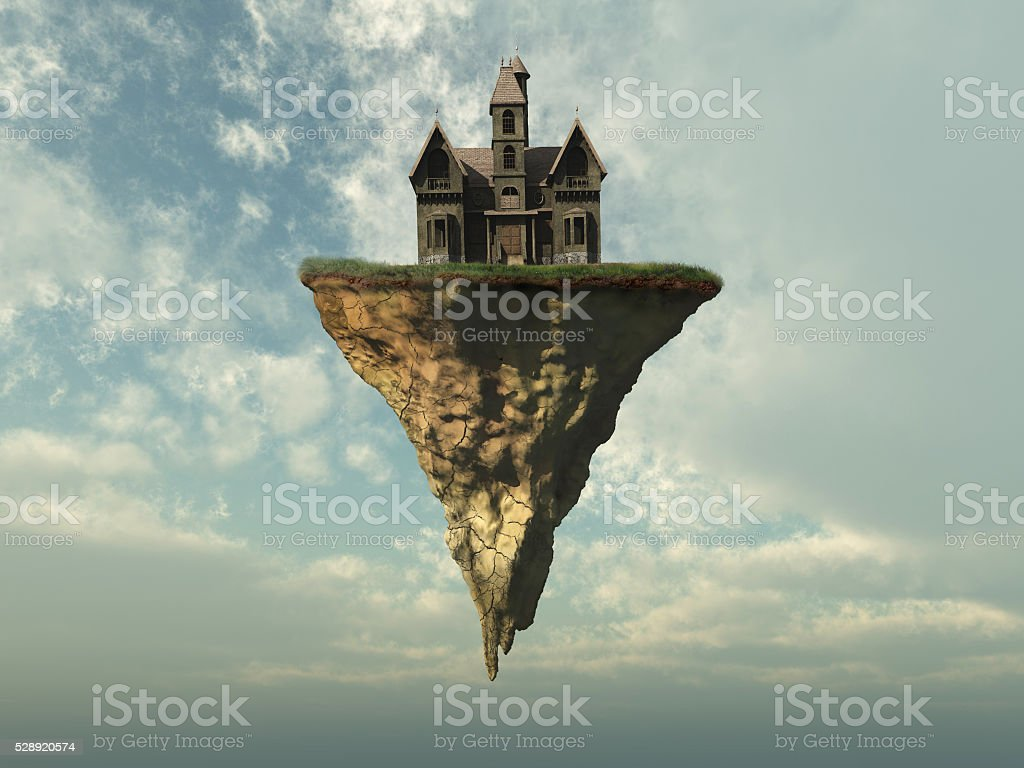 Old house on a piece of land in the sky stock photo