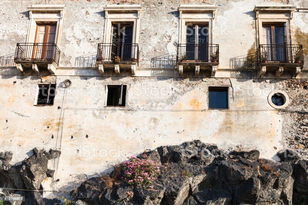 old house on volcanic rock base in Giardini Naxos stock photo