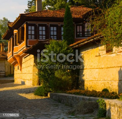 Sunny day shot of old house and streetSee more Vintage town recesses here: