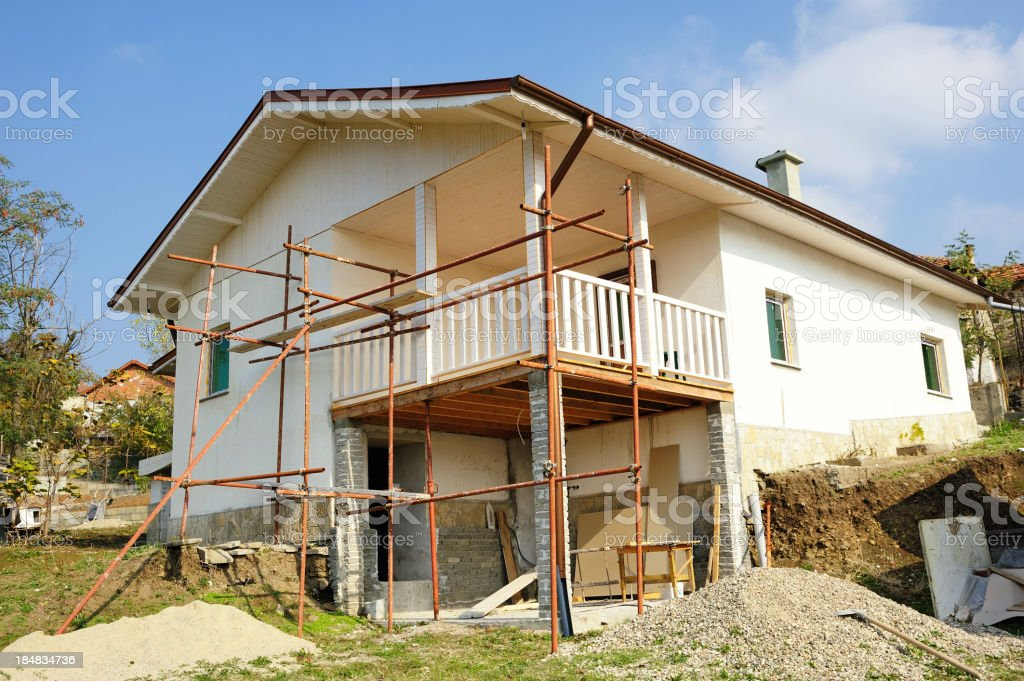 Old house restoration in a village royalty-free stock photo