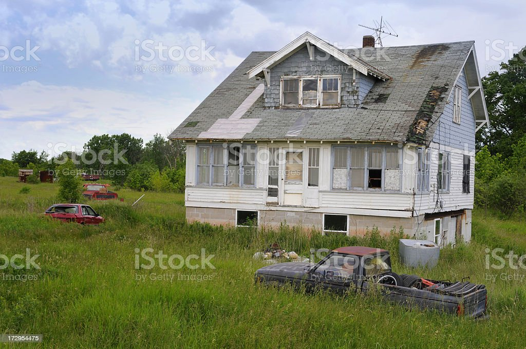 Old House, Rusty Truck; Abandoned, Ruined, Poverty, Foreclosure,Green Grass stock photo