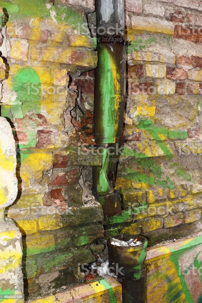 old house wall destroyed by damp stock photo