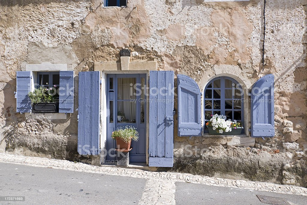Old House with Lavender Shutters stock photo
