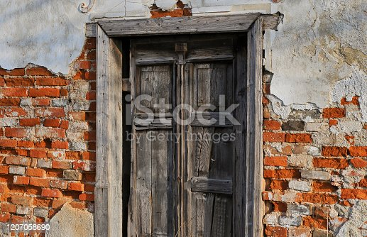 Old house with weathered wooden door