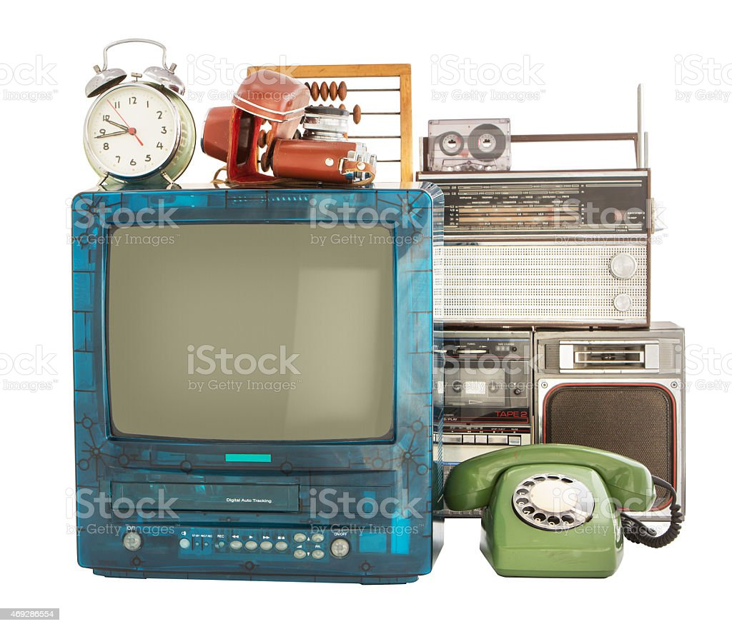 Old household items like clock radio rotary phone TV stock photo